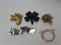Five Large Brooches